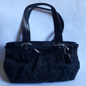 beautiful black coach bag with tag inside